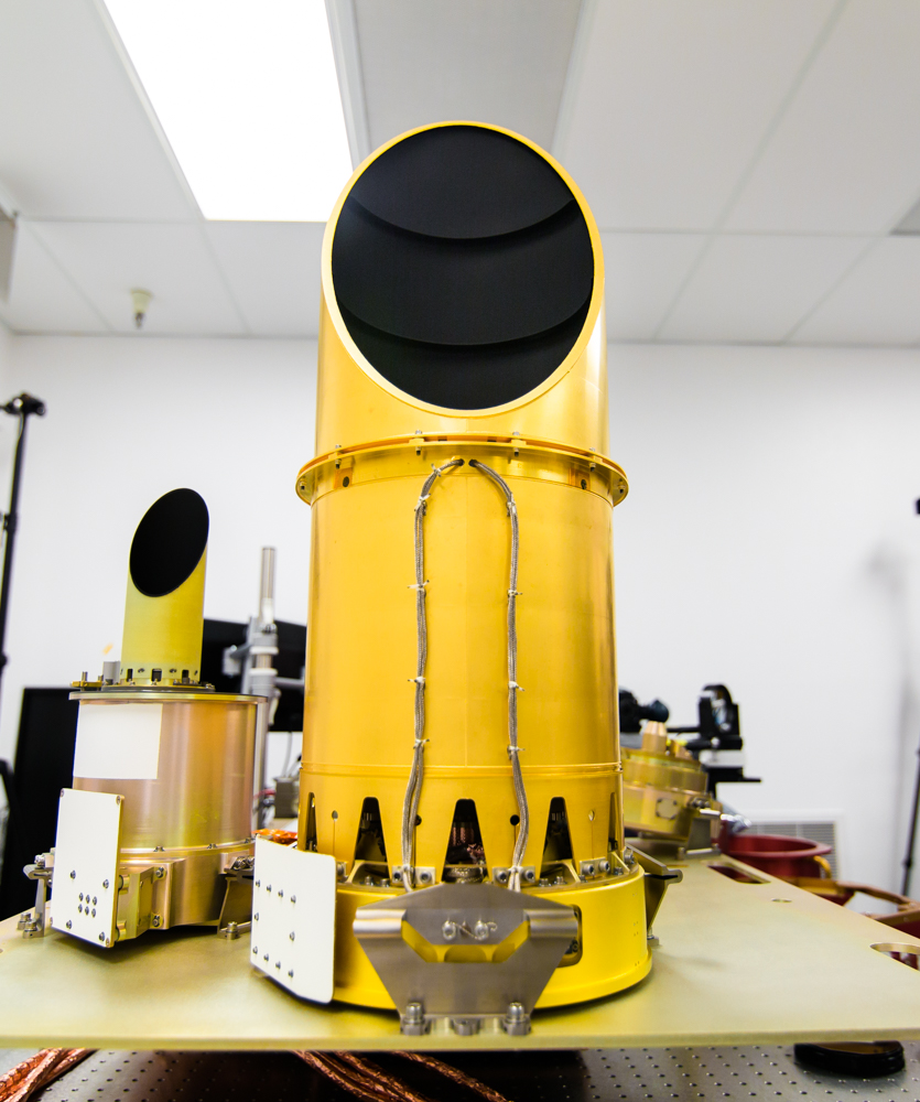 UA's completed camera suite, OCAMS, sits on a test bench that mimics its arrangement on the OSIRIS-REx spacecraft. The three cameras that compose the instrument are the eyes of NASA's OSIRIS-REx mission. They will map the asteroid Bennu, help choose a sample site, and ensure that the sample is correctly stowed on the spacecraft. Credit: University of Arizona/Symeon Platts