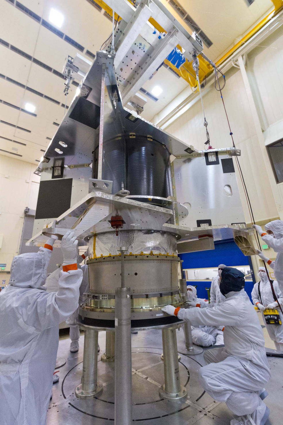 The OSIRIS-REx spacecraft core structure is successfully lowered and mated to the hydrazine propellant tank and boat tail assembly at Lockheed Martin, Denver, Colo. Credits: Lockheed Martin