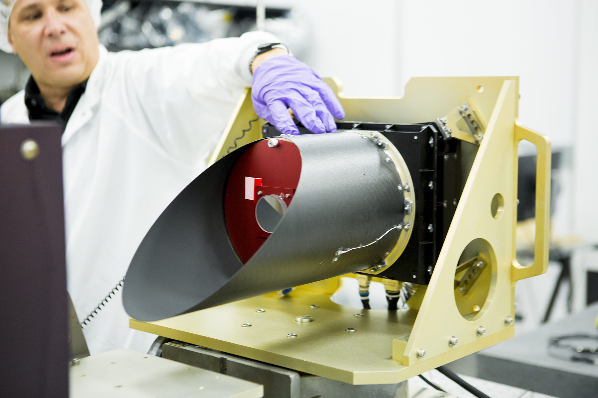 Greg Mehall, lead project engineer, describes the final testing procedures of the OSIRIS-REx Thermal Emission Spectrometer (OTES), on June 22. OTES is the first space instrument built entirely on ASU's Tempe campus. Credit: University of Arizona/Symeon Platts
