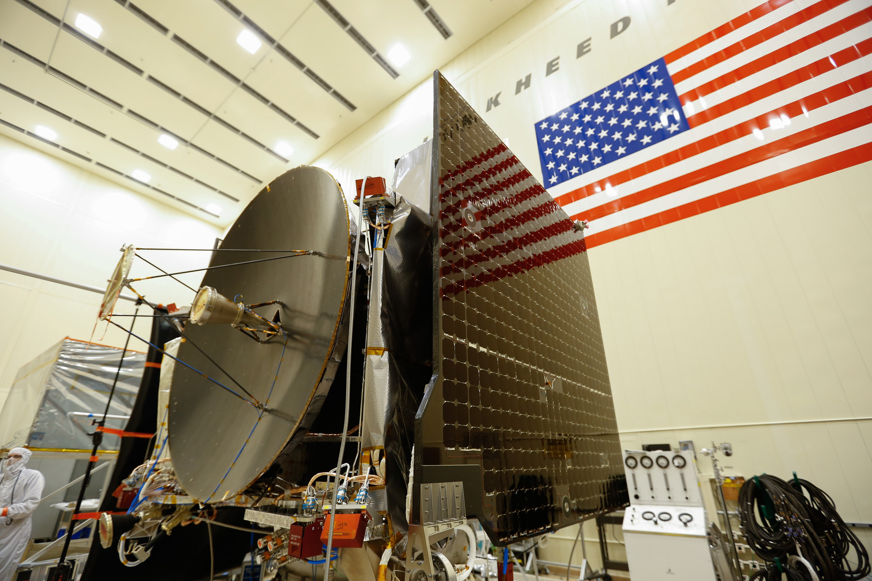 The high gain antenna and solar arrays were installed on the OSIRIS-REx spacecraft prior to it moving to environmental testing.  Credit: Lockheed Martin Corporation