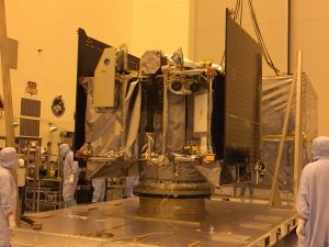 After arriving at NASA's Kennedy Space Center, the OSIRIS-REx spacecraft sits on a launch vehicle adapter ring in the Payload Hazardous Servicing Facility. Credit: University of Arizona/Erin Morton