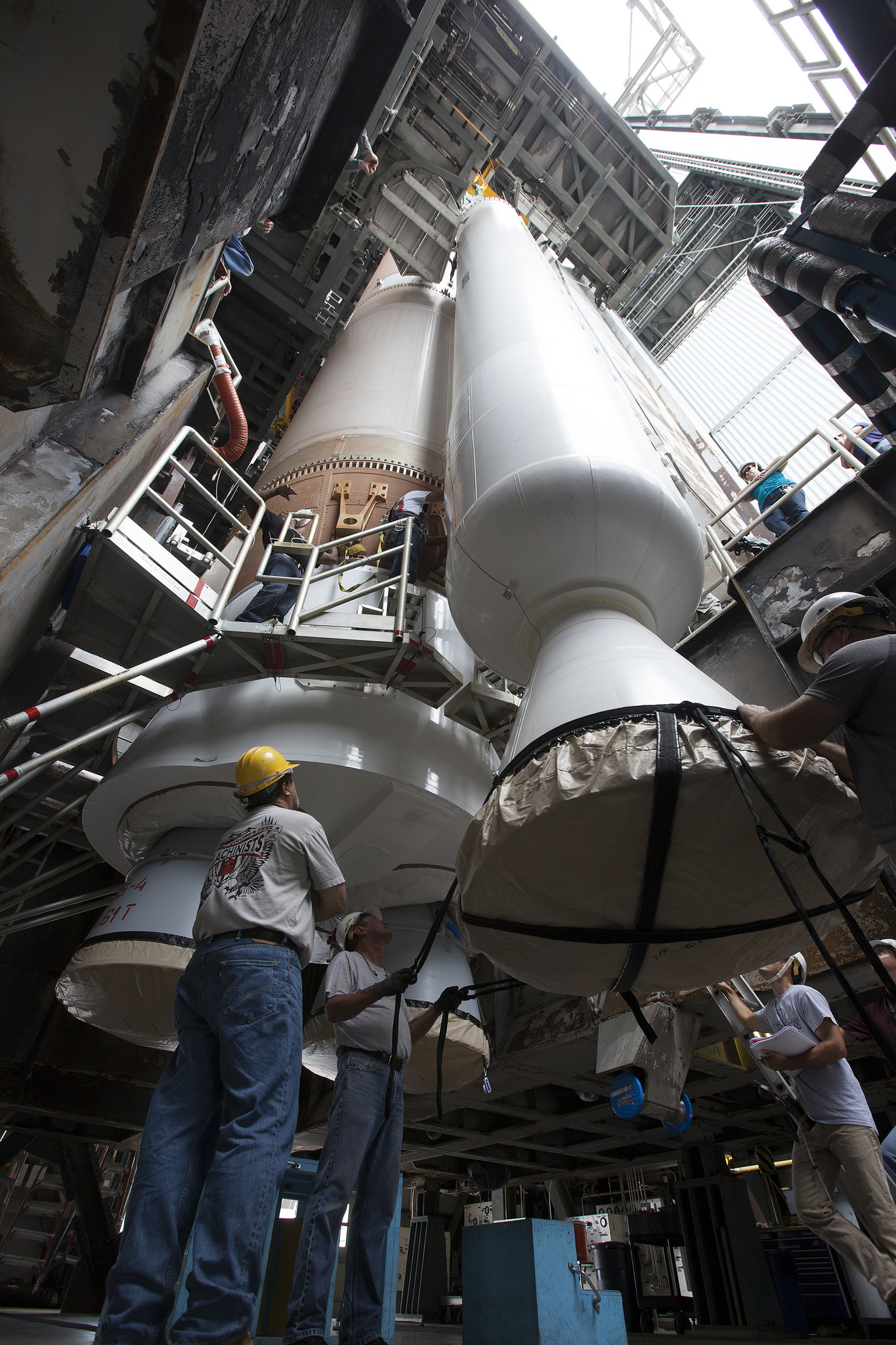 Solid Rocket Booster Guided Into Place